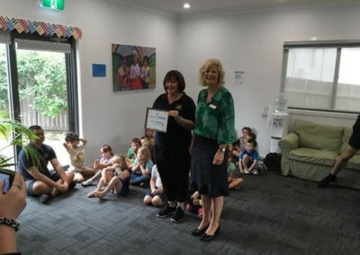 Jenny's Kindergarten receiving a certificate of recognition