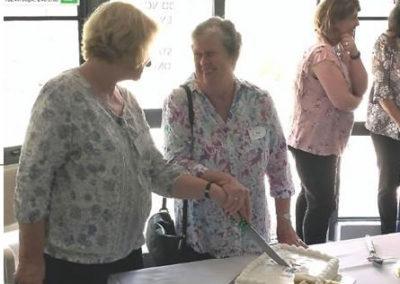 Margaret and Rita cutting the International Volunteer Day cake